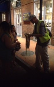 Nice Local passing out free beads on Bourbon St