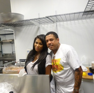 Althea coming to show some support to her hubby in the kitchen